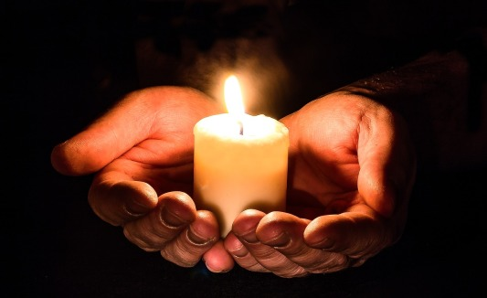 candle-in-hand-pixabay